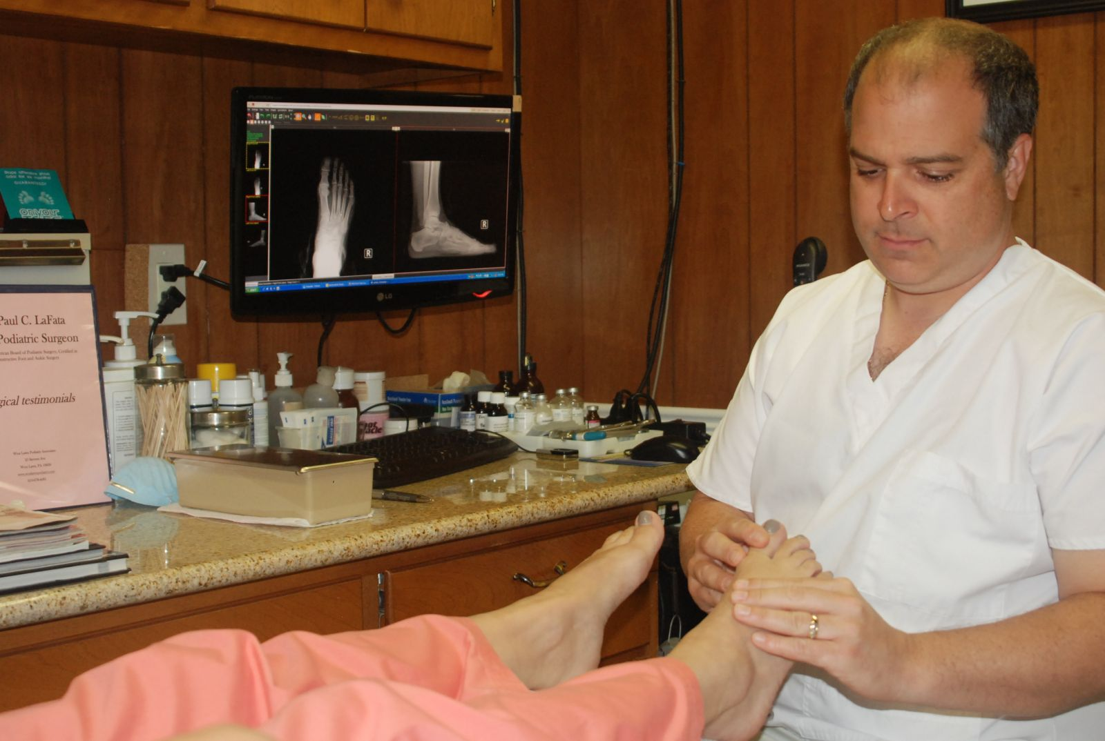 Dr. Paul C. LaFata Performing a Bunion Exam